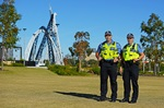 Two Police Officers stand at Park in East Perth.