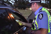 Police Officer conducts breath test