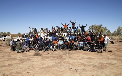 Group photo of people in the outback.