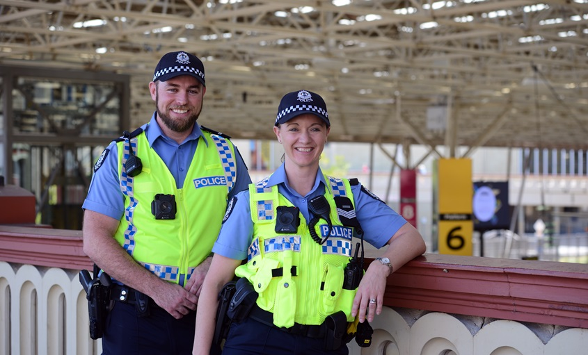 Police officers standing at Perth Train Station.