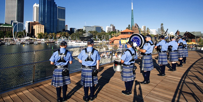 The WA Police Pipe Band takes part in the official opening of Elizabeth Quay in front of 25,000 spectators