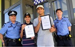 Two teenage boys are presented with certificates by Mundijong Police.