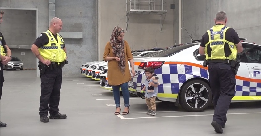 Traffic police with mother and child