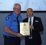 Commissioner presented with award for supporting Muslim community.